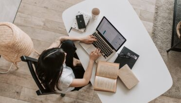 should you outsource seo lady working at desk